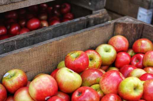 red and green apples in brown wooden box